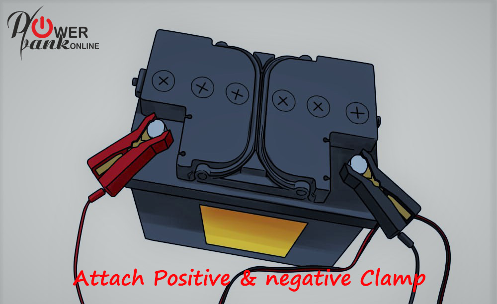 How to Charge a Car Battery - positive & negative clamps attached